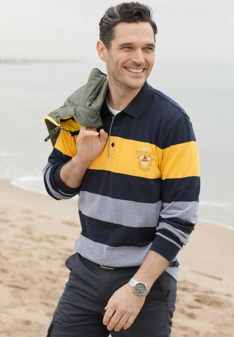 Babista - Polo shirt - marineblau,gelb