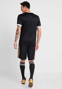 adidas Performance - REAL MADRID - Sports shorts - black/dark gold - 2