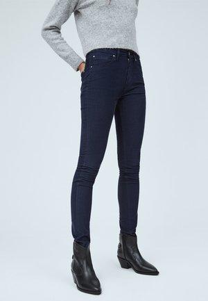 SKINNY FIT - Trousers - azul marino