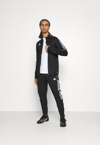 adidas Performance - TIRO 21 - Verryttelyhousut - black - 1