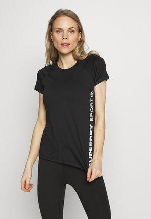 TRAINING ESSENTIAL TEE - T-shirt z nadrukiem - black