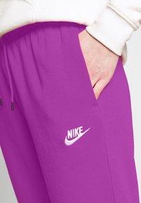 Nike Sportswear - Tracksuit bottoms - watermelon/white - 4
