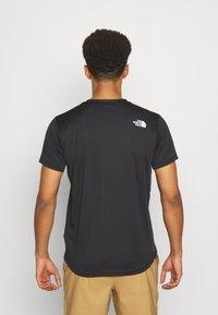 The North Face - MENS REAXION EASY TEE - Camiseta estampada - black - 2