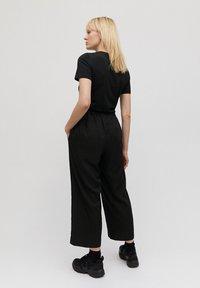 ARMEDANGELS - KAMALAA - Trousers - black - 2