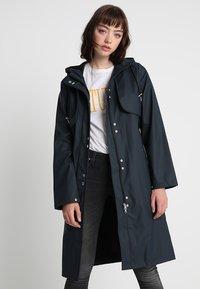 YAS - YASRAINA RAIN COAT - Waterproof jacket - carbon - 0