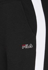 Fila - LAKI PANTS - Spodnie treningowe - black/bright white - 6