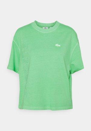 T-shirt con stampa - liamone