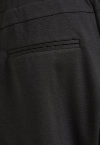 Cream - ANETT PANTS - Trousers - pitch black - 7