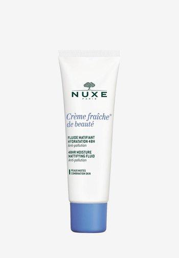 CRÈME FRAICHE® DE BEAUTÉ 48HR MOISTURE MATTIFYING FLUID - Face cream - -
