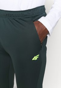 4F - Men's training pants - Tracksuit bottoms - green - 3