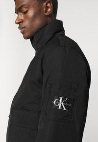 Calvin Klein Jeans - Giubbotto Bomber - black - 4