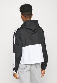 Nike Sportswear - Training jacket - black/white - 2