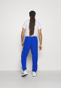 Lacoste Sport - TENNIS PANT TAPERED - Tracksuit bottoms - lazuli/black/white - 2