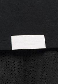 Puma - HOOPS BOUNCE TEE - Långärmad tröja - black - 5
