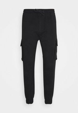 BADGE PANT - Cargo trousers - ck black