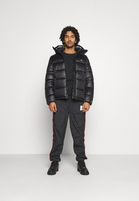 Champion Reverse Weave - HOODED JACKET - Winter jacket - black - 1