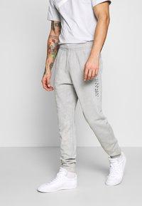 Nike Sportswear - JDI PANT FT WASH - Tracksuit bottoms - smoke grey/sail - 0