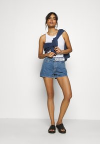 Calvin Klein Jeans - HIGH RISE - Denim shorts - light blue - 1