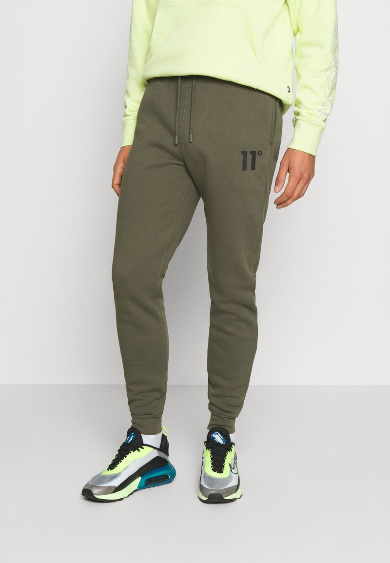 11 DEGREES - Tracksuit bottoms - khaki