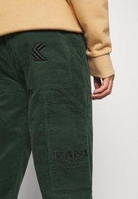 Karl Kani - PANTS - Trousers - green - 4
