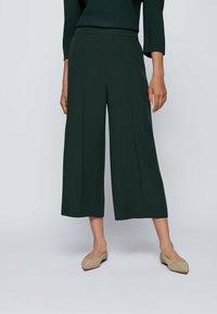 BOSS - Trousers - open green - 0