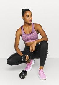 Nike Performance - FE/NOM FLYKNIT BRA - Medium support sports bra - beyond pink/bordeaux - 1