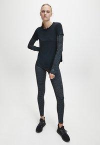 Calvin Klein - T-shirt sportiva - black - 1
