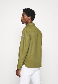 Tommy Jeans - CARGO JACKET - Summer jacket - uniform olive - 2