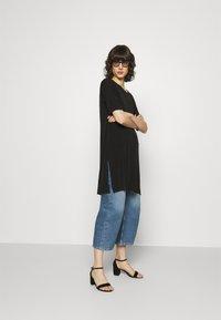 Lindex - TINNA TUNIC - Basic T-shirt - black - 1
