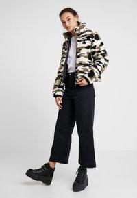 Urban Classics - LADIES CAMO SHERPA JACKET - Winter jacket - wood - 1