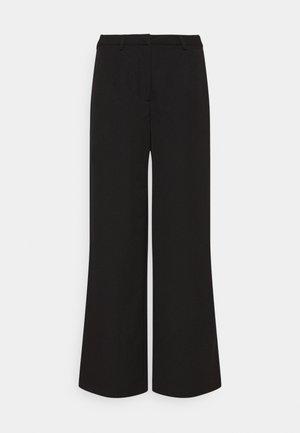 LESSA  - Trousers - black