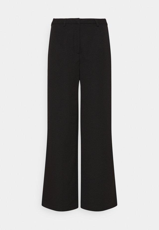 LESSA  - Pantaloni - black