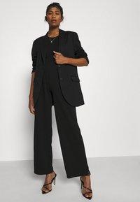 Noisy May - NMJASA LONG PANTS - Trousers - black - 3