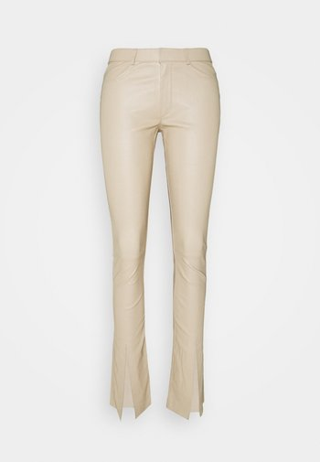 FLAG - Leather trousers - latte
