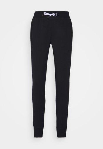STATUS PANTS WOMEN - Verryttelyhousut - black