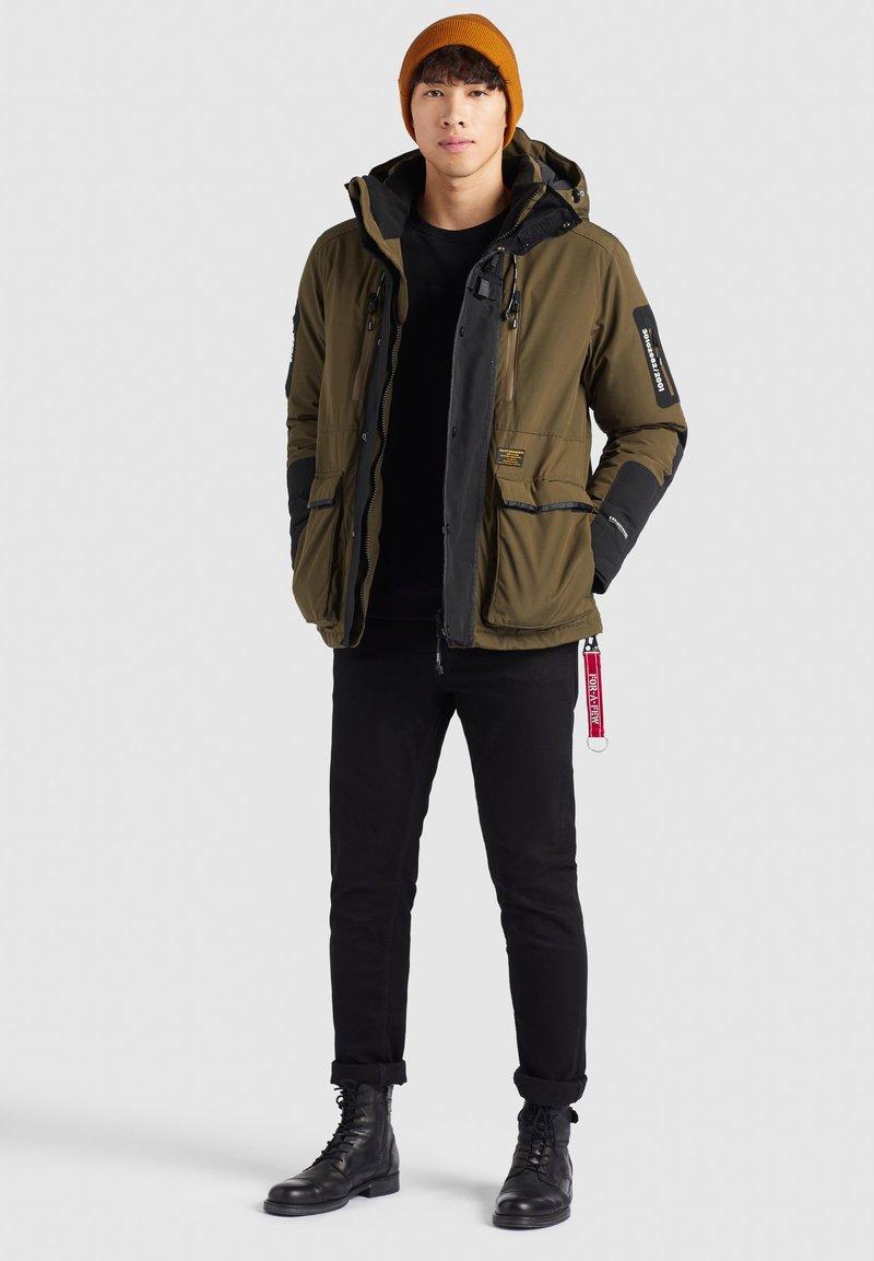 khujo - NANDU - Winter jacket - oliv-schwarz kombo