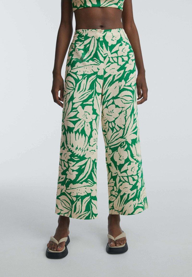 OYSHO - TROPICAL - Trousers - green
