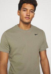 Nike Performance - TEE CREW SOLID - Basic T-shirt - light army/black - 3
