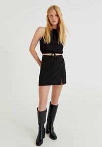 PULL&BEAR - MIT SCHLITZ - A-line skirt - black - 1