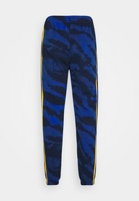 adidas Originals - ZEBRA - Tracksuit bottoms - navy - 1