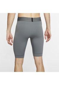 Nike Performance - DRY YOGA - Leggings - iron grey/black - 2