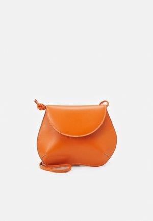 PEBBLE MINI BAG - Across body bag - orange