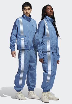 IVY PARK NYLON TRACK PANTS (ALL GENDER) - Pantalones deportivos - light blue