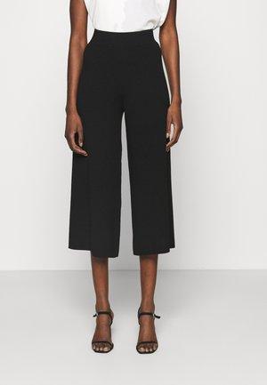 CAIUS - Trousers - black