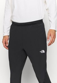 The North Face - ACTIVE TRAIL HYBRID JOGGER - Pantalon de survêtement - black - 3