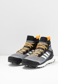 adidas Performance - TERREX FREE PARLEY - Hiking shoes - core black/footwear white/solar gold
