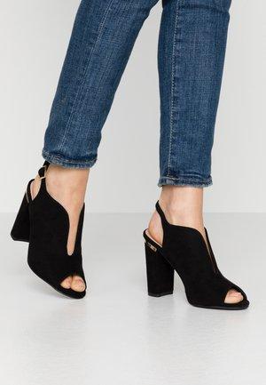SKYLAR - Sandály na vysokém podpatku - black