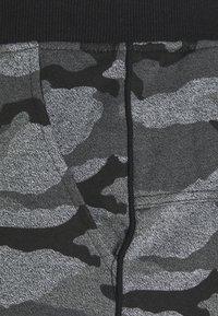 Schott - Tracksuit bottoms - black - 2
