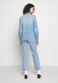 Vero Moda - VMMARIA SLIM  - Button-down blouse - light blue denim/birch - 2
