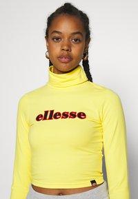 Ellesse - VORAN - Langærmede T-shirts - yellow - 4